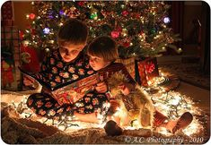 SO SWEET!  Reading a Christmas book to your little brother.