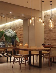 There is lower lighting above the dining room table and higher light fixtures above the walkways. Dining Room Design, Dining Area, Dining Table, Appartement Design, Apartment Makeover, Dining Room Lighting, Küchen Design, Home Living Room, Sweet Home