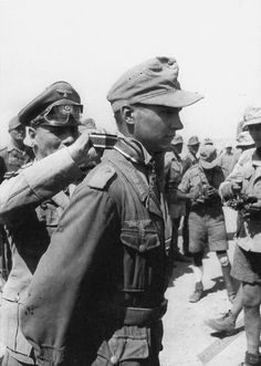 "Field Marshal Erwin Rommel awards the Knight's Cross to Corporal Gunther Halma, Jul/22/1942. During the battle of El Alamein, Halma,104th Grenadier Regiment, directed the fire of an anti-tank PaK-36 gun that destroyed nine British ""Valentine"" tanks from the 23rd Armoured Brigade within minutes."