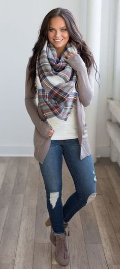 #winter #outfits beige and blue plaid shawl, gray cardigan, white top, and distress blue-washed jeans outfit