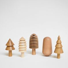 A collection of 5 hand made wooden tree ornaments. These collectible tree ornaments are hand-turned on a lathe and each tree is unique. We use off-cuts form~ Wooden Tree, Wooden Shapes, Tree Shapes, Outdoor Christmas Decorations, Holiday Decor, Beautiful Gift Boxes, Wood Toys, Handmade Wooden, Wooden Gifts