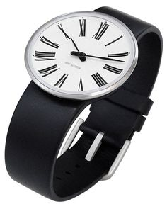 The Rosendahl AJ Romer Watch is based upon Arne Jacobsen's classic Romer clock. This watch has a 40mm diameter with white face and black calfskin band. It features a Rosendahl ISA-35 Swiss movement with a 925 watch cell battery, double convex hardened mineral crystal, a solid stainless steel case and time adjustments by using center pressure on the rear case with a pointed object.