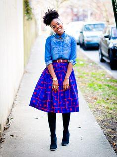 denim shirt, brown belt, bold skirt, black shoes & tights.