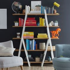 Utlitarian rule. The open shelves on our Ladder Bookshelf provide plenty of space for books and knicknacks, and its contrasting vertical dividers give it a modern and minimal profile.