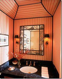 Alessandra Branca powder room. Fabric covered walls with ribbon trim.
