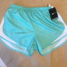 Nike dri-fit tempo shorts size medium Brand new with tags Nike Dri-Fit tempo running shorts! The shorts are printed in light blue-green and teal colors with a silver Nike swoosh on the front. They are in perfect condition! Nike Shorts