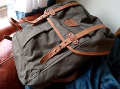 The Fjallraven Rucksack No.21 is an outstanding bag. It's the right combination of simple, effective, and extremely durable. Check it out.