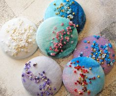 Buttons- french knots and beaded embroidery beaded+buttons French Knot Embroidery, Beaded Embroidery, Embroidery Stitches, Hand Embroidery, Embroidery Patterns, Art Patterns, Japanese Embroidery, Flower Embroidery, Embroidered Flowers