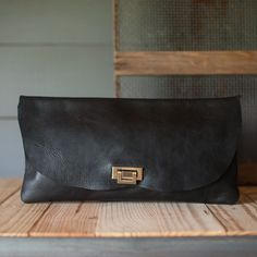 Bison clutch from Stash Co. out of Sealy, Texas! Leather and vintage textiles. Sparrow Bar servers in Houston are wearing Stash leather aprons.