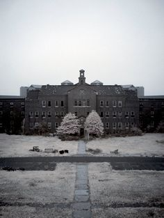 "Pilgrim State Hospital - ""originally designed to house 12,500 patients on 1900 acres of land"" - constructed from 1930-1941 in Brentwood, New York, USA.  "" . . . holds the record of being the largest psychiatric hospital in the world"" when population peaked at 16,000."