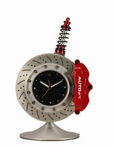 Caliper, shock and disc from your scrap bin becomes basis for a clock--probably a twitchy quartz clock-- with a little aluminum paint and red enamel.