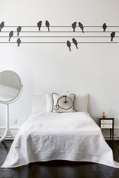 I wish our bedroom looked like this! love the floors and the white walls/bedding