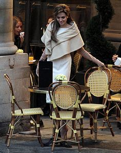 Angelina in The Tourist: camel wrap, ivory sheath dress, suede opera gloves