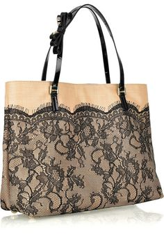 Nude raffia bag with black floral scalloped lace overlay. Valentino bag has silver hardware, a designer-stamped plaque at front, two black patent-leather top handles with bow embellishment, internal zip-fastening and pouch pockets and is fully lined in black satin.