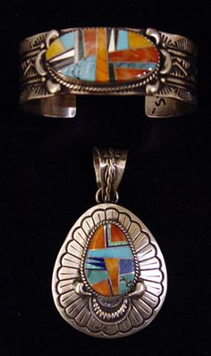 Artist:  Charles Johnson.  Sterling Silver inlaid cuff with Turquoise & Coral, $625  AND  Sterling Silver inlaid pendant with Turquoise & Coral $400