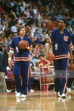 New York Knicks Ernie Grunfeld (18) and Bill Cartwright (25) on court before game vs Houston Rockets James Bailey (2) at The Summit. Andy Hayt F7 )