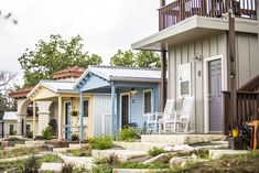The article gives photos and videos of examples of the types of tiny house communities including diy build, those for the homeless, Tiny House Village, Building A Tiny House, Tiny House Big Living, Home And Living, Backyard Coop, Pocket Neighborhood, Tiny House Community, Micro House, Tiny House Movement