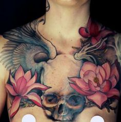 Amazing skull and lotus chest tattoo