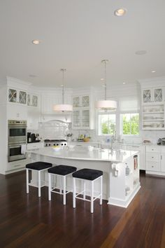 absolutely beautiful kitchen - except I wouldn't do white. Kitchen colors should reflect a warm, cozy environment - too much white gives a medicinal feeling.