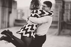 #adult #black and white #blur #city #couple #embrace #fun #happy #hug #love #man #outdoors #outfit #people #person #portrait #romance #smiling #street #togetherness #urban #wear #woman