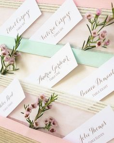 pastel ribbons, delicate pink florals accent this vintage escort card