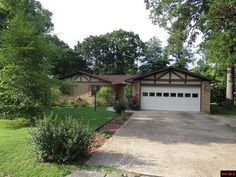 NORTHERN HILLS, immaculately maintained, mostly brick, 3 BR 2 BA home featuring: foyer, brick fireplace in LR, sunroom, built-ins in 3rd BR being used as office, updated master shower, 14'x10' open deck, fenced backyard, storage building and new roof in 2009 in Mountain Home AR