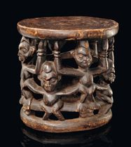 Cameroon Grassfields, Babanki wood, blackish brown patina, ring-shaped base, supporting a cylindrical corpus: consisting of standing figures, arranged in two levels, interwined by their limbs, plane seat on top, slightly dam., cracks, minor missing parts, paint rubbed off  H: 47 cm; D: 47 cm African Style, African Art, African Fashion, African Furniture, Ring Shapes, Art Auction, Tribal Art, Metal Working, Sculptures