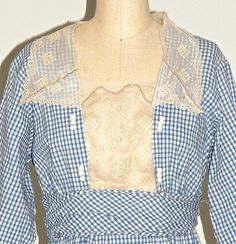 Authentic 1910s Edwardian blue gingham day dress with embroidered eyelet trim.  *Scalloped square trim collar neckline *Embroidered eyelet bodice inset *Triple knots accent sides of inset *3/4 length sleeves with trim *Gathered cummerbund with back sash *Gathered skirt with diagonal side pockets featuring trim & fabric knots *Snap and eye/hook closures  Label: None Content: Cotton Color; Blue, white, off-white  Estimated Modern Size: Small / 6 VS Bust: 35 Waist: 27 Hip: 48 Length: 48 1/2 to…