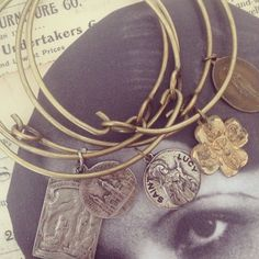 Bangles with vintage Religious  medals. Vintageflair.typepad.com