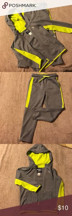 4T Toddler Boys track suit Gray and lime green 4T boys track suit. The pants have a skinny leg fit. The hood is zipper with front pockets. Never worn but tags were removed Osh Kosh Matching Sets