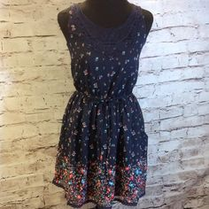 BEAUTIFUL NAVY FLORAL PRINT DRESS BY ULTRA PINK This is such a sweet dress with a floral print and a lace appliqué at the neck as well as a tie belt waist and pockets   Like new Ultra Pink Dresses Mini