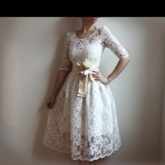 I adore this dress! The lace and the sash are perfection.