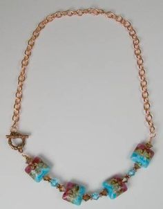 Free Tutorial Bib-Style Copper, Lampwork, and Crystal Necklace