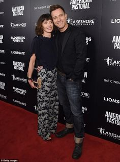 Red carpet romance: Ewan and his wife Eve Mavrakis cosied up at the screening...