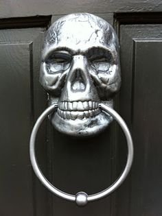 Cover door knocker with spray-painted skull from the Dollar Tree.
