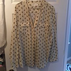 Two Vince Camuto studded button blouse Cream top with black polka dots and red/tan design. V-neck blouse with studded buttons and detail on shoulders with the same. Front pockets on breast are pleated. Perfect with skinny jeans and booties. Vince Camuto Tops Blouses