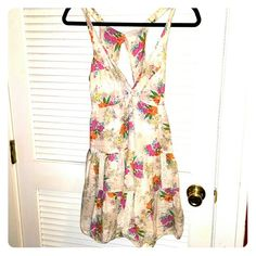 Billabong Cutout Sundress This light and breezy summer frock in a flirty floral print features a deep-V with a small cutout, delicate crochet details and an elegant open back - perfect for a hot summer day. Billabong Dresses Mini