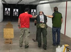 """11 More Awesome New Guns, Gear, and Ammo Products from SHOT 2016, The shooter and his two """"volunteers"""" are whacking a steel plate with an AR-15 from a distance of six inches."""