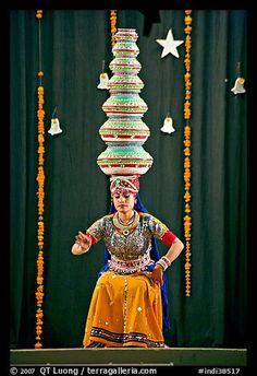 Rajasthani dancer balancing jars on head. New Delhi, India (color)