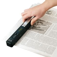 Magic Wand Scanner. It saves images as JPG files that can be uploaded to the computer. Great for when you only need a few pages from a book and don't want to check it out or buy it!