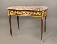 A Wonderful Late 19th Century Louis XVI Style Gilt Bronze Mounted Center Table