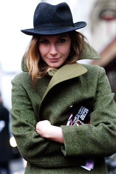 Hats are back! Great fresh take on a fedora, paired with a mossy green jacket