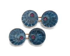 A PAIR OF GOLD AND ENAMEL CUFFLINKS, ST PETERSBURG, 1908-1917 each circular link enamelled in translucent cerulean over scalloped wavy engine-turning radiating from a cabochon ruby, 56 standard, illegible marks Quantity: 2 diameter 1.5cm, 1/2 in.