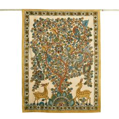 A richly stylized tree of life in traditional kalamkari painting. Preserving the historic tradition of kalamkari textile art, Andhra Pradesh artisans hand-paint vegetable dyes to create this exquisite design. In modern times, block printing has replaced hand painting.