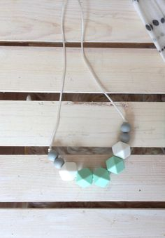 Lovely mint, grey and white silicone beads on a white coloured silk cord with a white breakaway clasp.