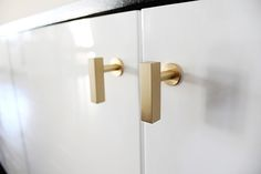 MadeByGirl: I found the perfect pulls while reading Erika's kitchen renovation post. She's got such great style that I didn't even question it & purchased them via myknobs.com.  I bought 8 brushed brass pulls for a total of $61.
