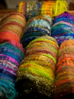 Beautiful colors and texture... prefelt wool rovings a rainbow of colour