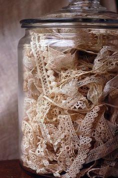 Jar of vintage lace.