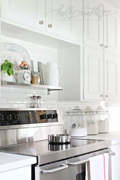 Classic subway tile, white cabinets, stainless shelf