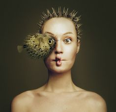 Hungarian photographer Flóra Borsi is an eyeful. Animeyed, her latest project, features animals superimposed over self-portraits so that the two faces overlap, sharing one eye in common. The surreal effect is compounded by Borsi's use of colors and props that make her look more like the creature sharing the photo.